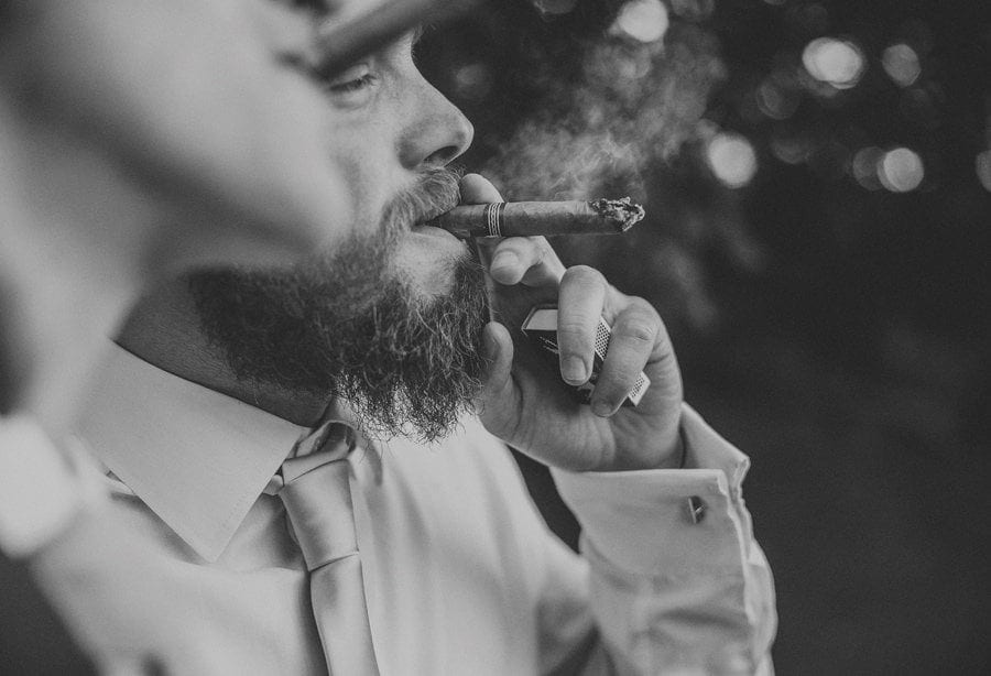 The best man puts a cigar in his mouth