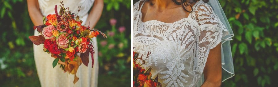 The bride holds her bouquet of flowers in both hands in her parents back garden