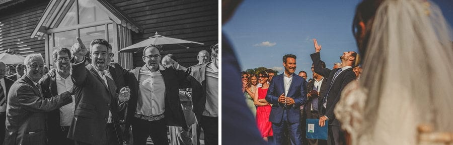 The groom points towards the outdoor ceremony at Micklefield Hall