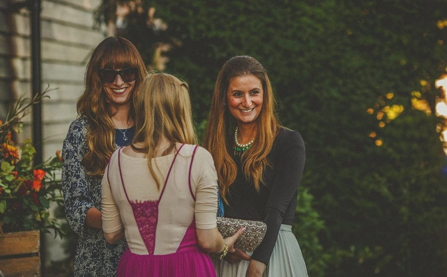 A lady chats with friends at Micklefield Hall wedding venue