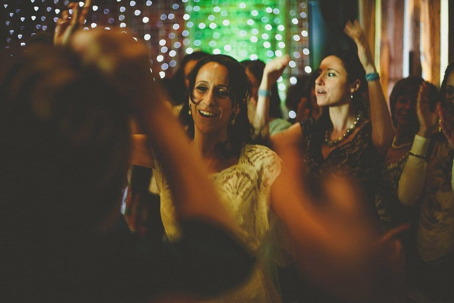 The bride dances with her family on the dancefloor at Micklefield Hall