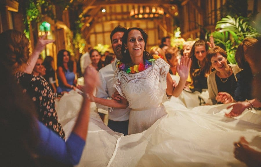 The bride and groom dance together on the dancefloor in the old barn at Micklefield Hall