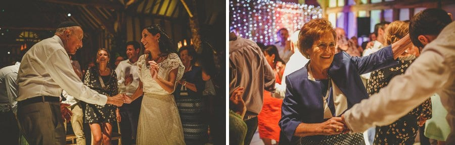 The bride dances with her family on the dancefloor