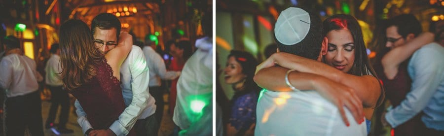 Wedding guests dancing with their partners on the dancefloor