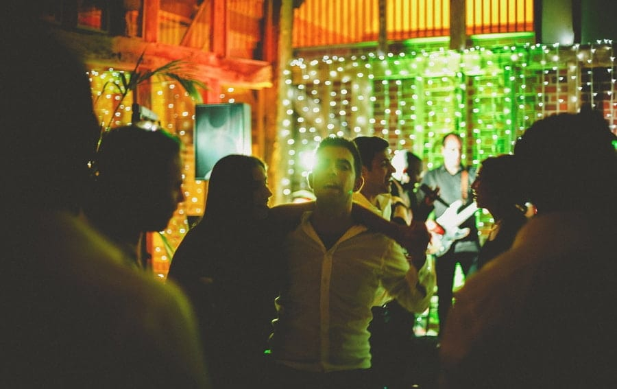 A wedding guest dances with his wife in the barn at Micklefield Hall