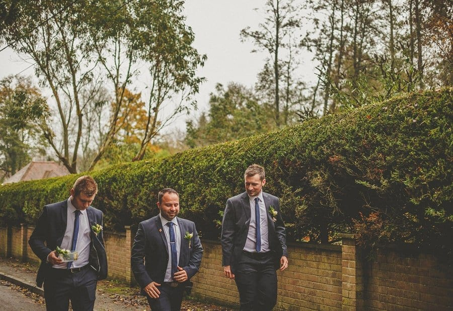 The groom and the ushers walk towards Sopley Mill