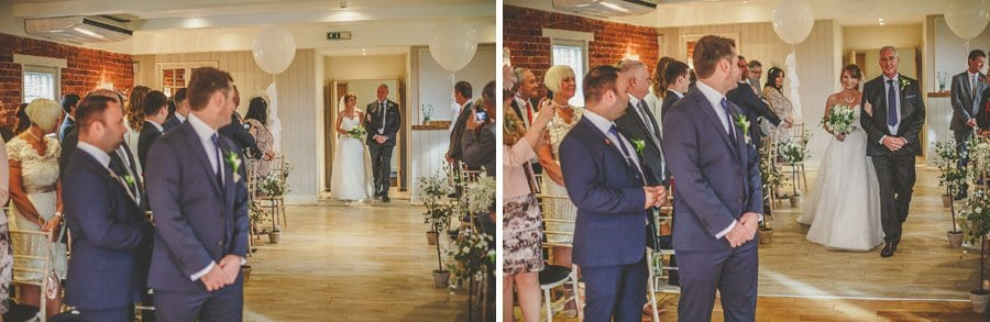 The bride and her father walk down the aisle towards the groom at Sopley Mill