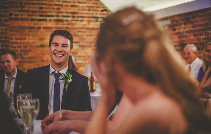 A wedding guest laughs during the wedding speechs