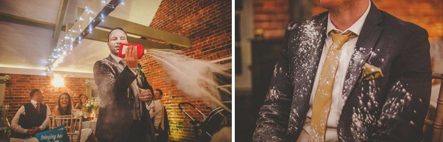 The best man pours talcum powder over a wedding guest during his speech