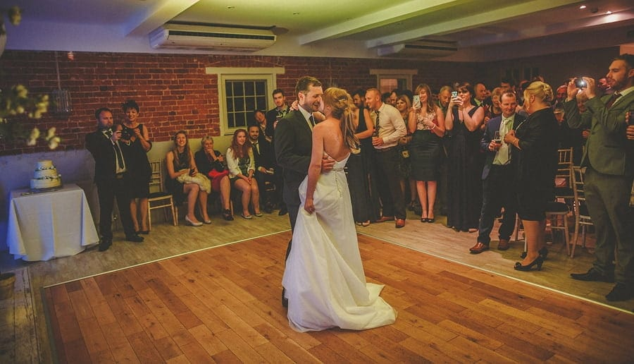The bride and groom dance in front of wedding guests at Sopley Mill