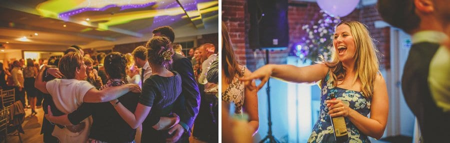 Wedding guests embrace each other on the dancefloor at Sopley Mill