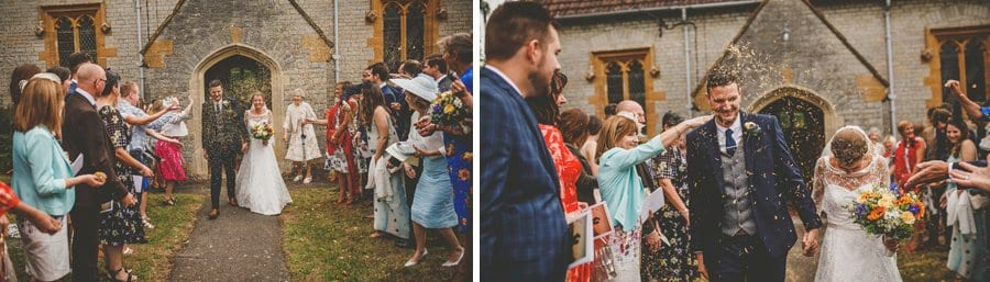 The bride and groom leave the church as wedding guests throw confetti in the air