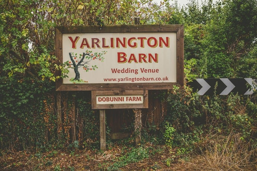 A large wooden sign outside Yarlington Barn in Somerset