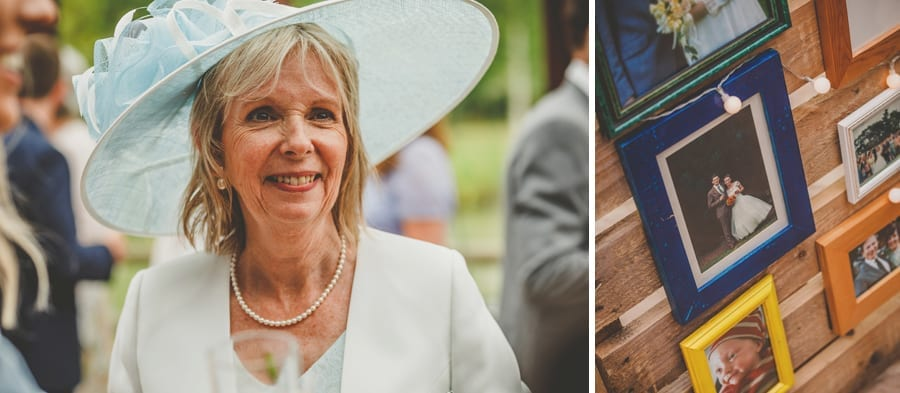 The bride's mother smiles as she poses for a photograph