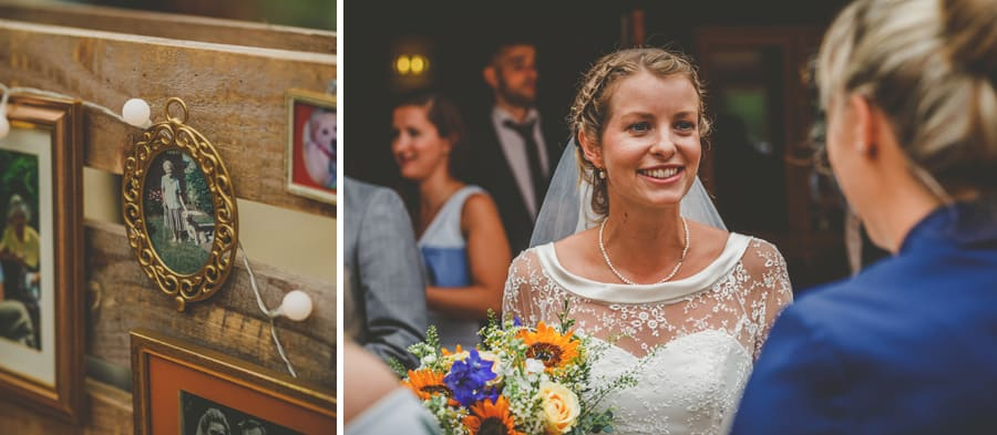 The bride smiles as she chats to a member of her family at Yarlington barn in Somerset