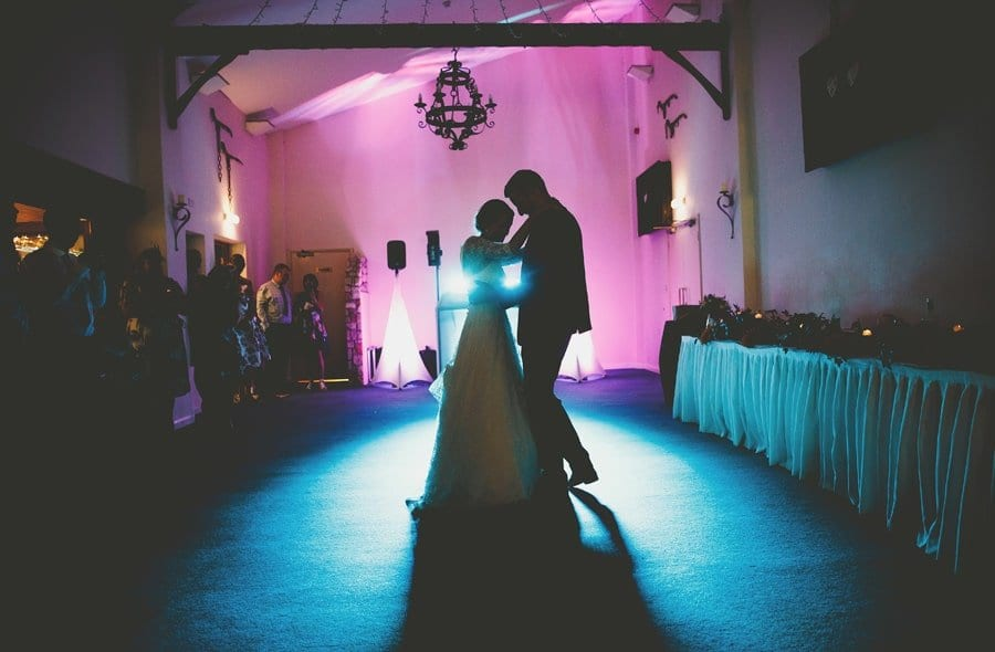 The bride and groom dance together on the dance floor at Yarlington barn in Somerset