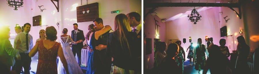 Wedding guests dancing together at Yarlington barn