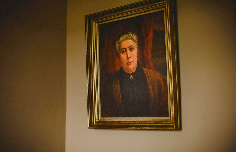 An oil painting hangs from a wall in the brides mother's house