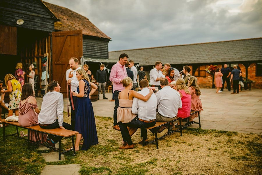 Wedding guests congregate in the courtyard at Over Barn