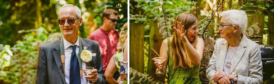 Wedding guests chat to each other in the woods at the Yurt Retreat, Crewkerne