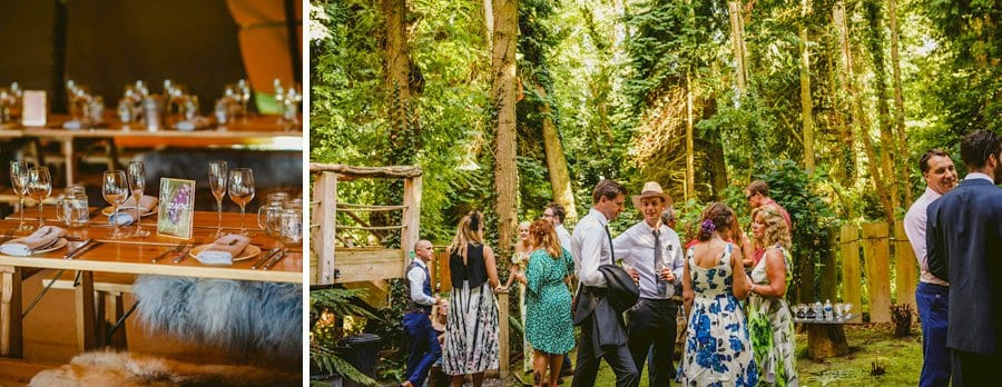Wedding guests chat amongst themselves in the woods at yurt retreat