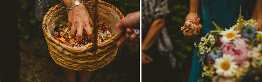 Wedding guests pick up confetti from a wicker basket outside the house