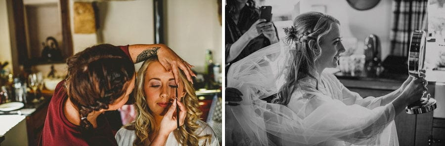The makeup artist applies makeup to the brides face in the kitchen