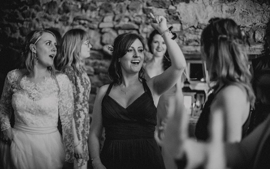 A bridesmaid dancing on the dancefloor in Eden Barn