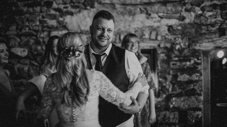 The bride and groom dancing together at Eden Barn