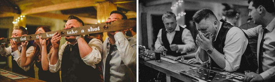 The groom and his ushers drink alcoholic shots at the bar in Eden Barn