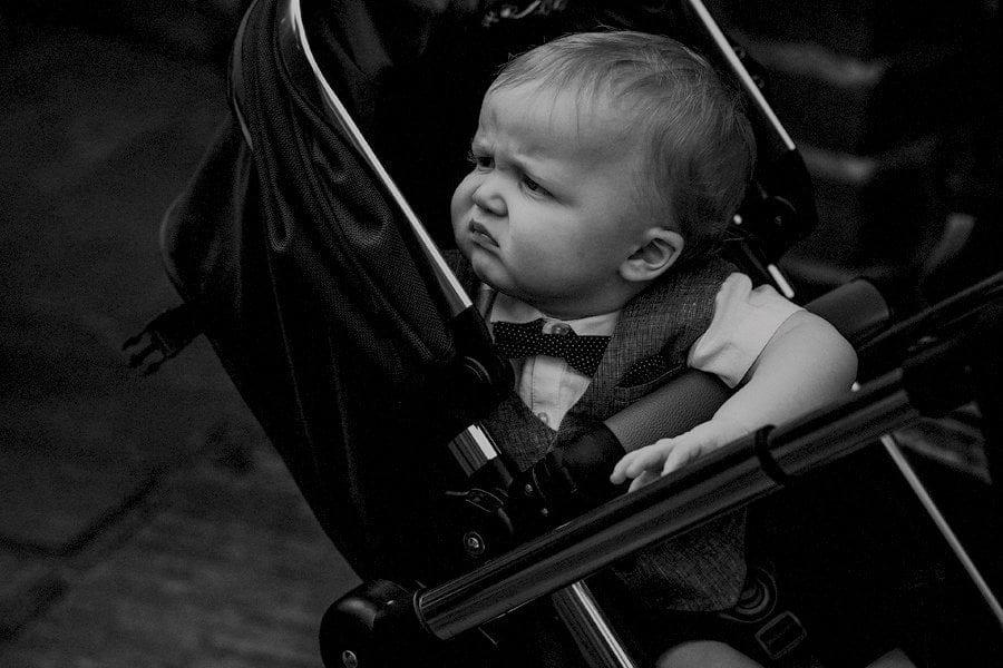 A child sat in a pram