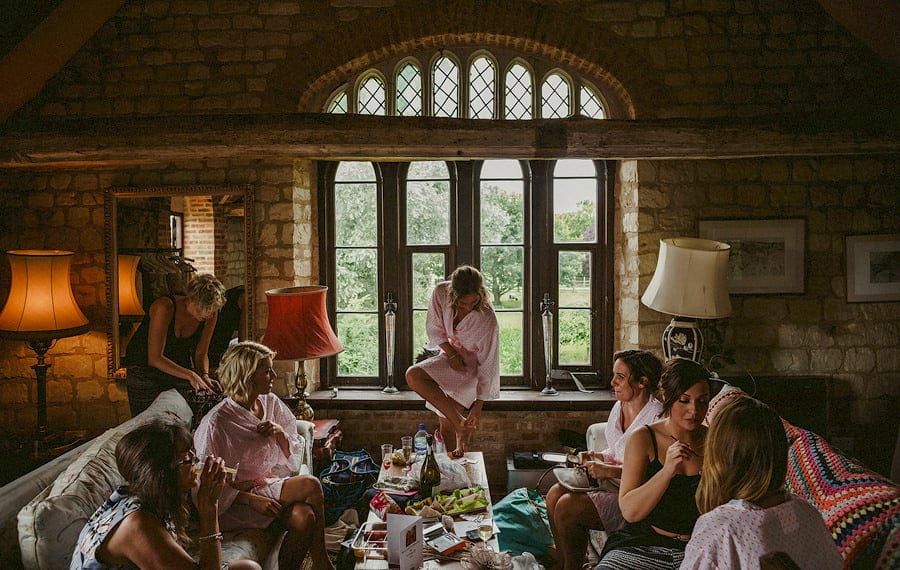 The bride and the bridesmaids get ready in the old barn at Childerley Estate in Cambridgeshire