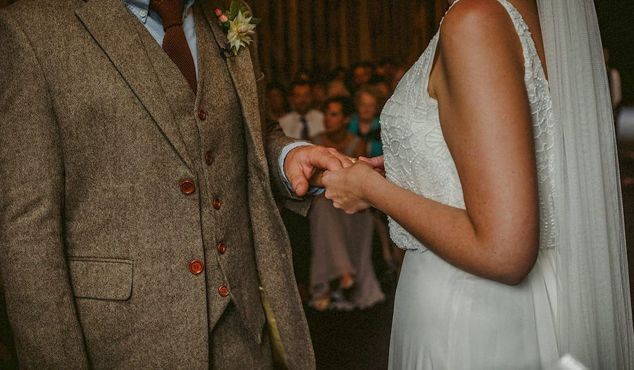 The bride holds the hand of the groom during the wedding ceremony