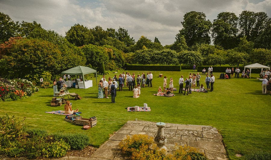 Wedding guests congregate on the back lawn at Childerley Estate