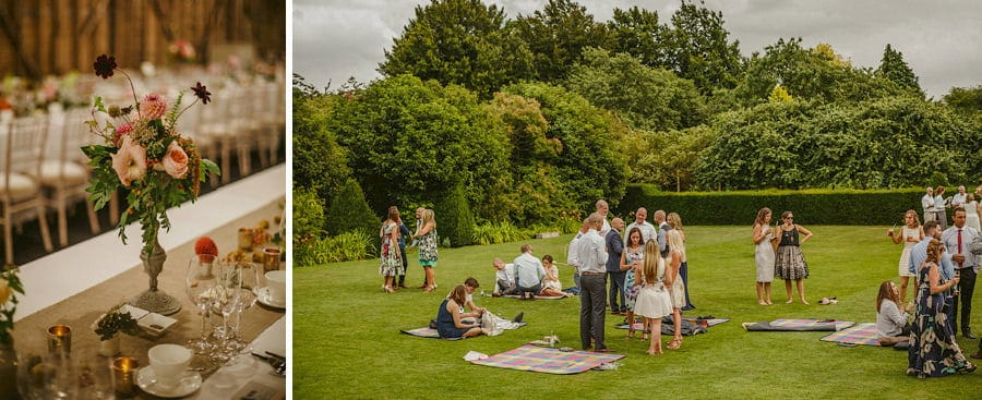 Wedding guests chat amongst themselves on the lawn at Childerley
