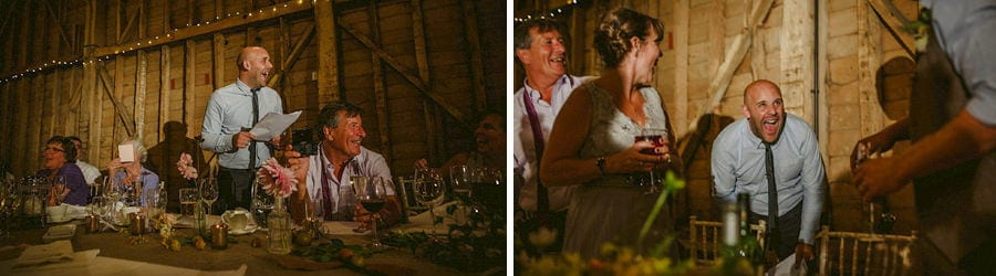 The best man delivers his speech to the wedding party in the old barn