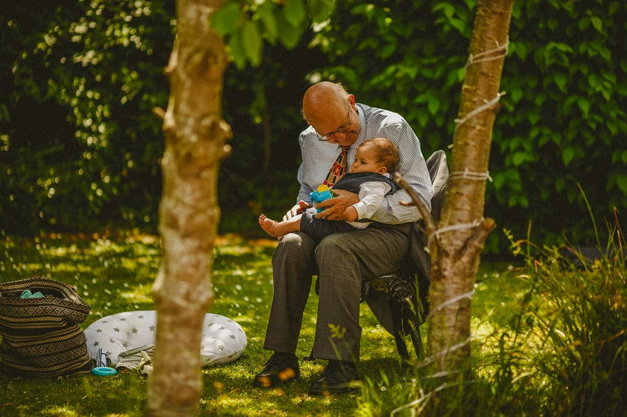 A man holds his great grandson