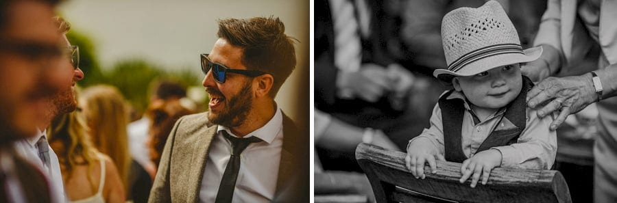 Wedding guests laugh and chat with each other