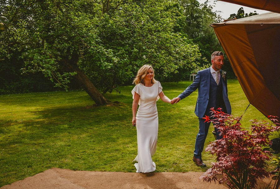 The bride and groom enter the tipi