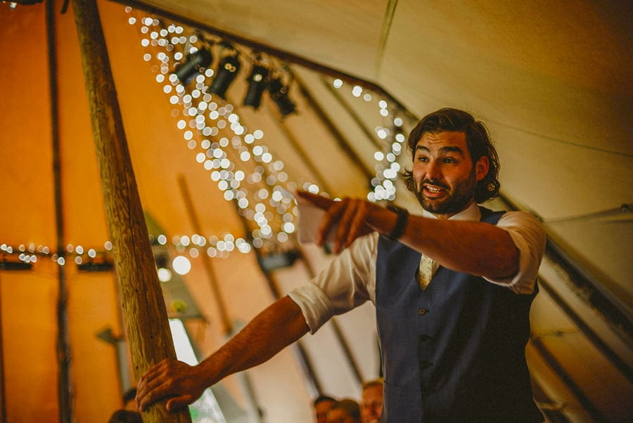 The best man delivers his speech in the tipi