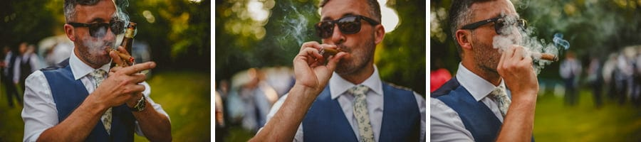 The groom lights up his cigar