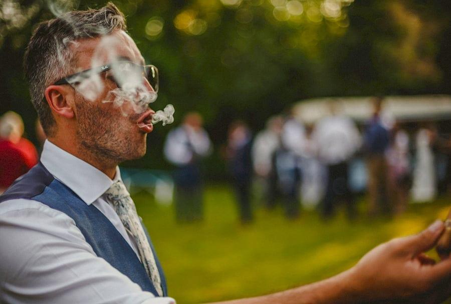 The groom enjoys a cigar