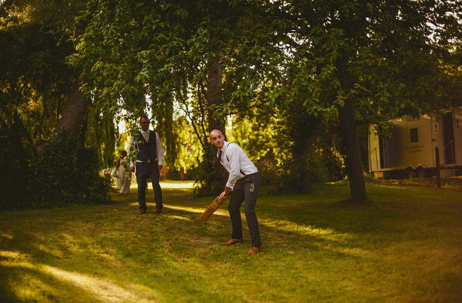 The ushers playing cricket in the back garden