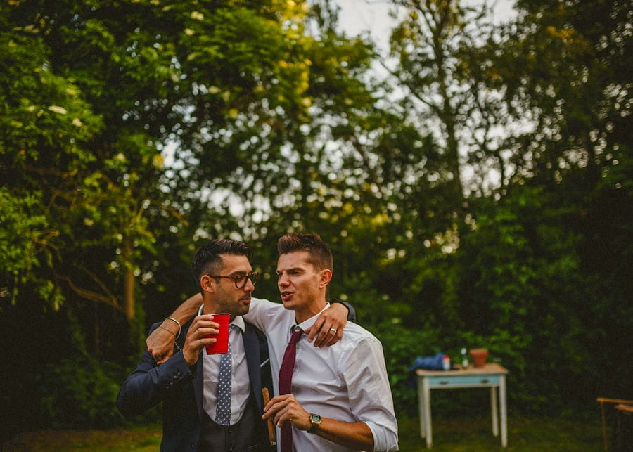Wedding guests drinking alcohol together