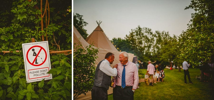 Wedding guests share a joke in the garden
