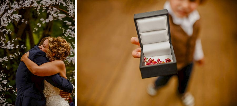 The bride and grooms son holds a box with confetti inside it