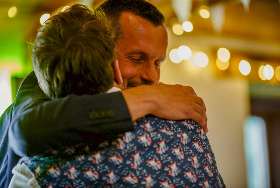 The best man hugs the groom
