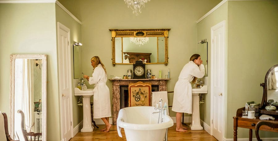 Bridesmaids getting ready at Pennard house, Somerset