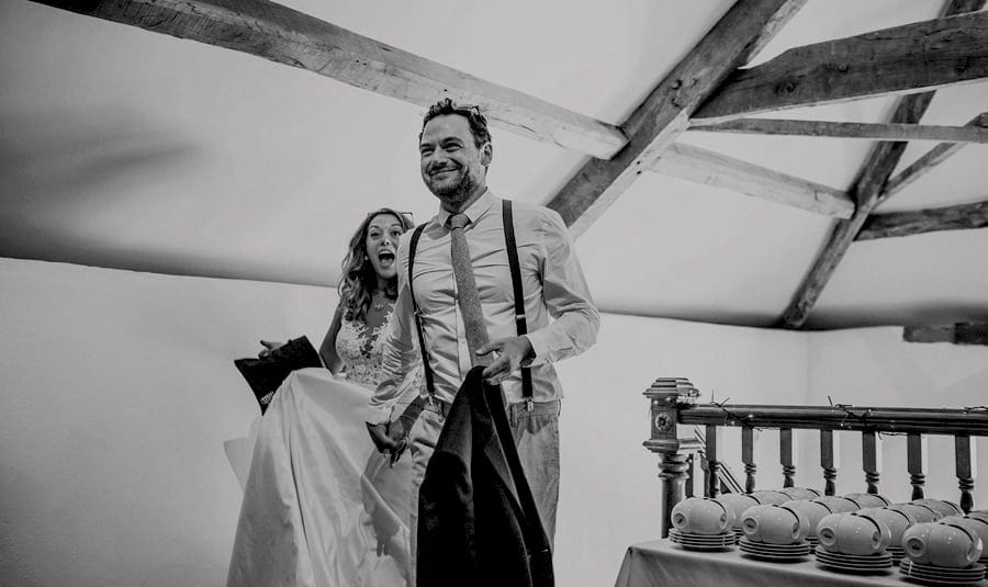 The bride and groom arrive in the old barn at Pennard house, Somerset