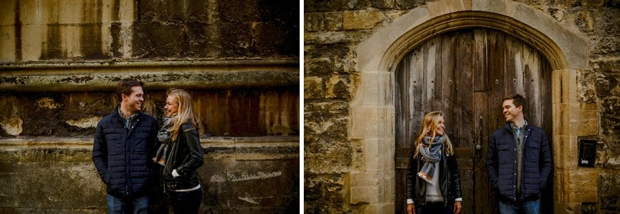 A man and lady look at each other and smile next to a wall and a doorway in Oxford